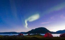 Landscape with tents by fjord and aurora borealis at night, Narsaq, Vestgronland, South Greenland — Stock Photo