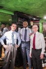 Three tailors in traditional tailors shop — Stock Photo