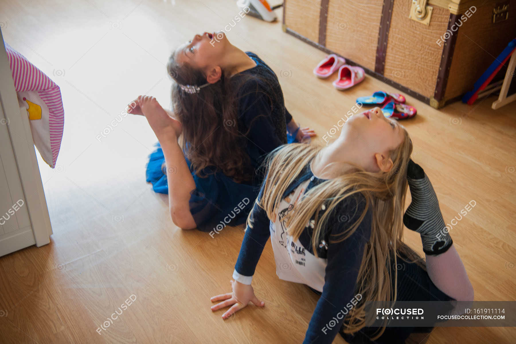 girls stretching with toes touching heads — stock photo | #161911114