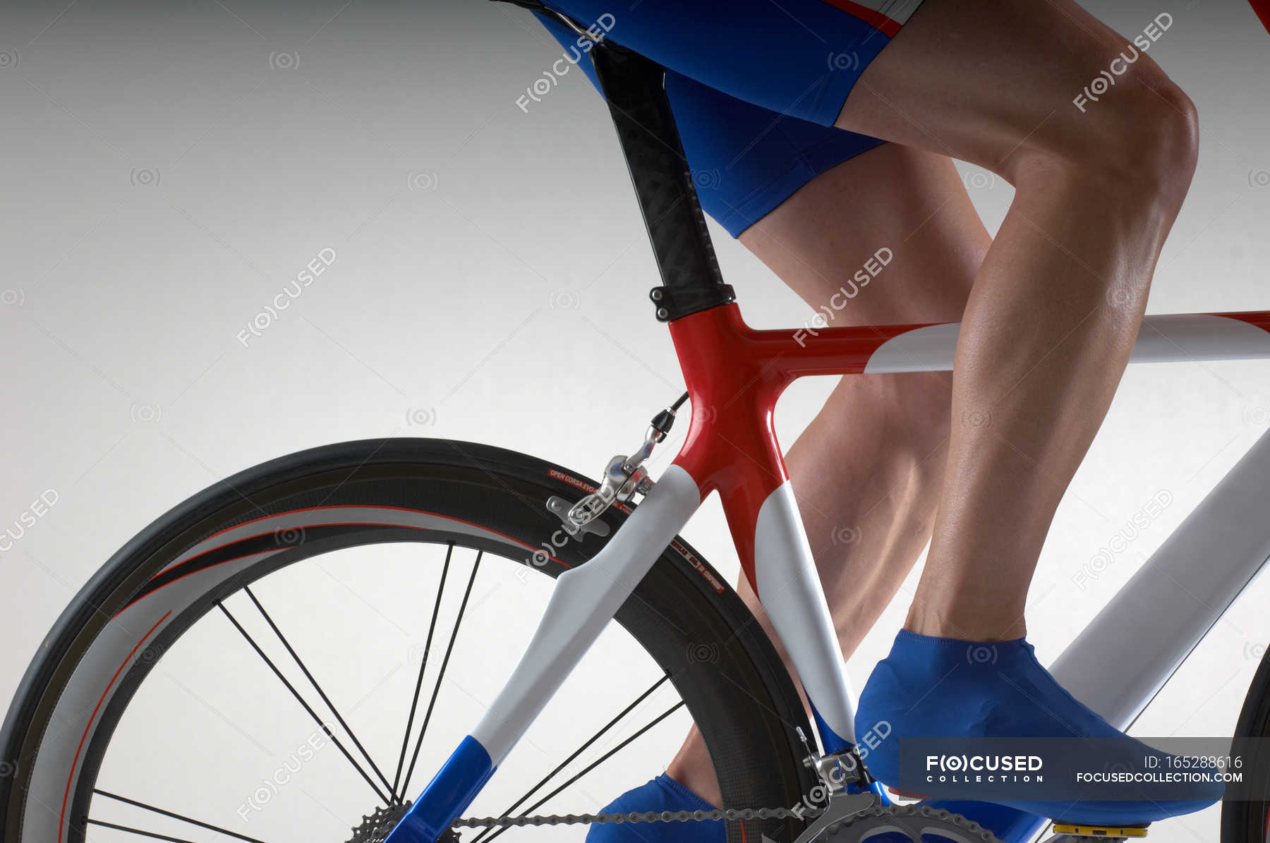 Cyclist with time trial bicycle — side view, one person