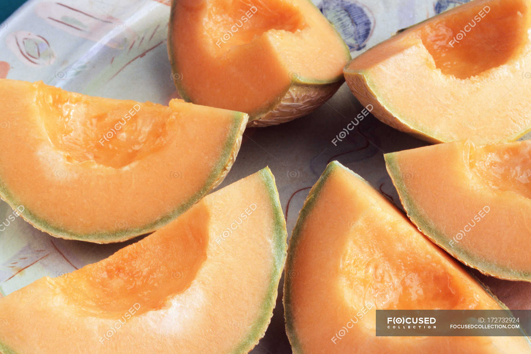 Juicy Cantaloupe Melon Slices On Plate Ripe Sweet Flavor Stock Photo 172732924 Cantaloupe has been linked to illnesses in several instances in the past. https focusedcollection com 172732924 stock photo juicy cantaloupe melon slices plate html