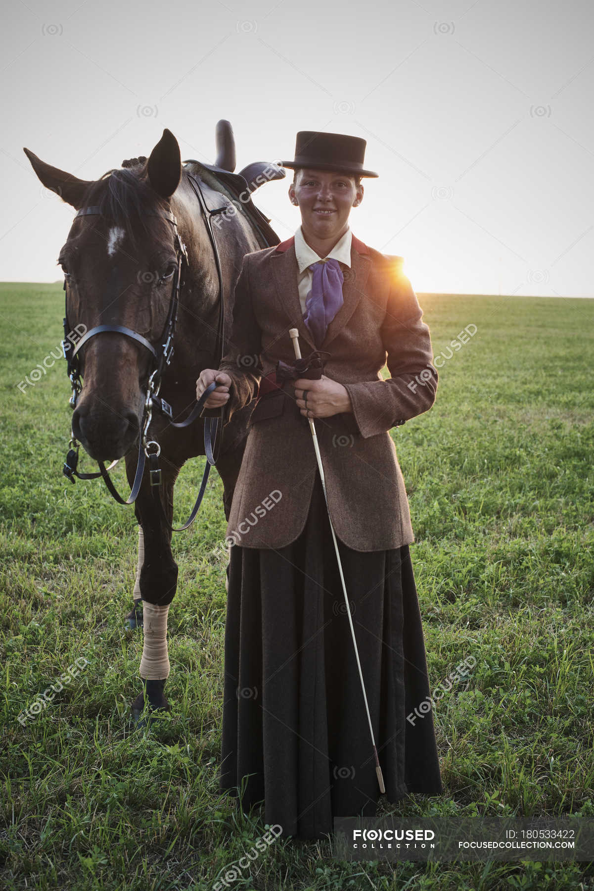 Portrait Of Woman Standing With Dressage Horse In Field Smiling Germany Stock Photo 180533422