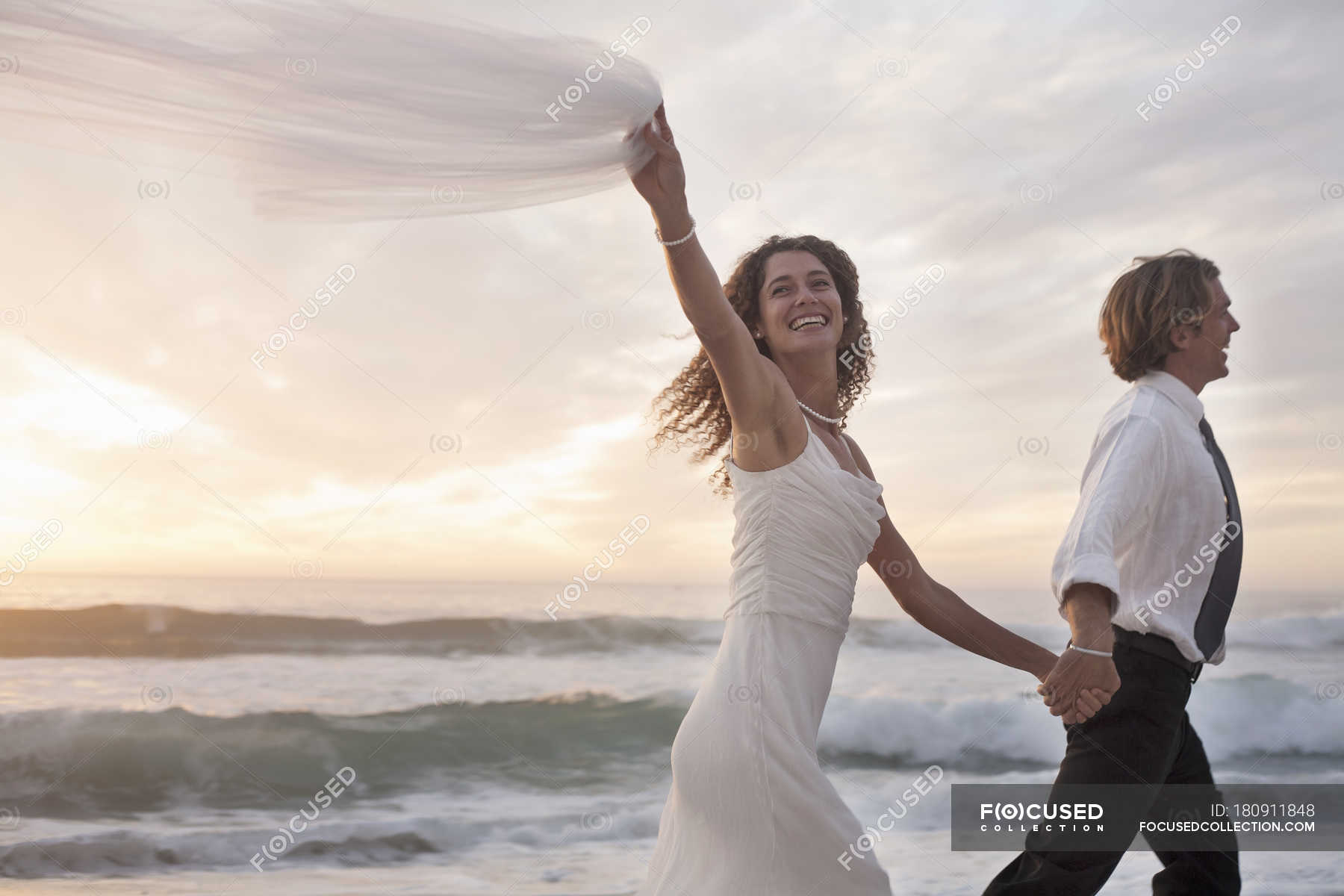 Awesome Bride And Groom Running On Beach Against Sunset Wedding Download Free Architecture Designs Scobabritishbridgeorg