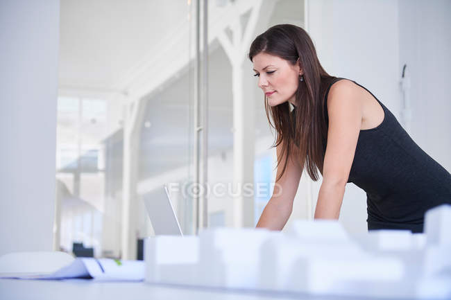 Architect in office with architectural model — Stock Photo