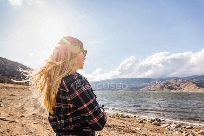 Woman with flyaway long blond hair — Stock Photo
