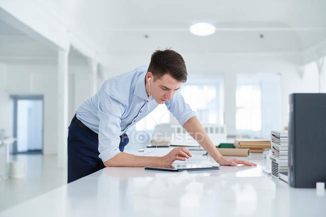 Man working in open plan office — Stock Photo