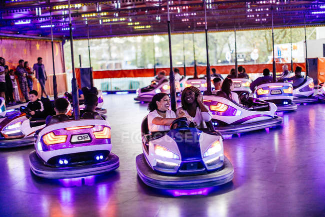 Group of friends at funfair — Stock Photo