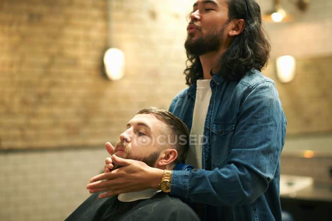 Hairdresser grooming customers beard — Stock Photo
