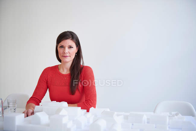 Architect with architectural model — Stock Photo