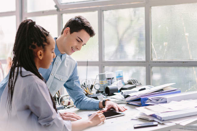Colleagues using digital tablet — Stock Photo