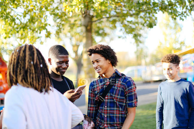 Group of friends in park — Stock Photo
