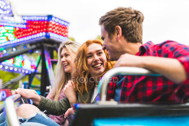 Group of friends on fairground ride — Stock Photo