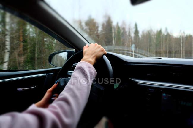 Woman driving vehicle — Stock Photo