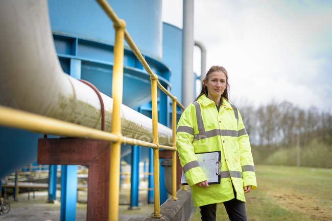 Female ecologist with waste water plant — Stock Photo