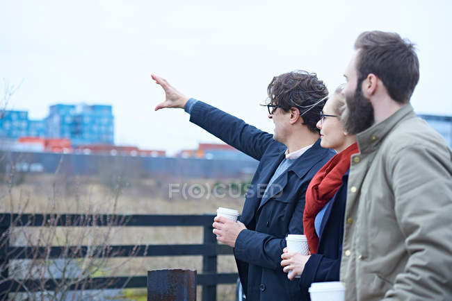 Design team pointing outside — Stock Photo