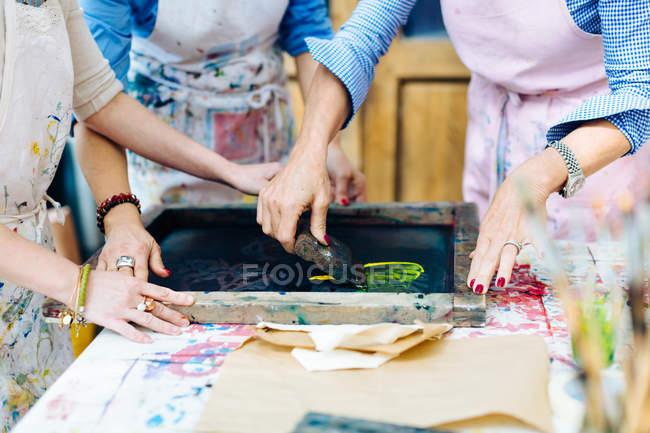 Women working on silk screen print — Stock Photo