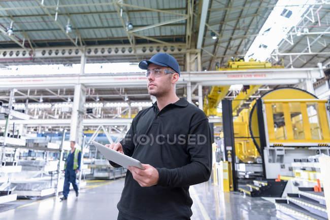 Apprentice engineer in steel pressing department — Stock Photo