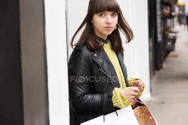 Female shopper waiting on street — Stock Photo