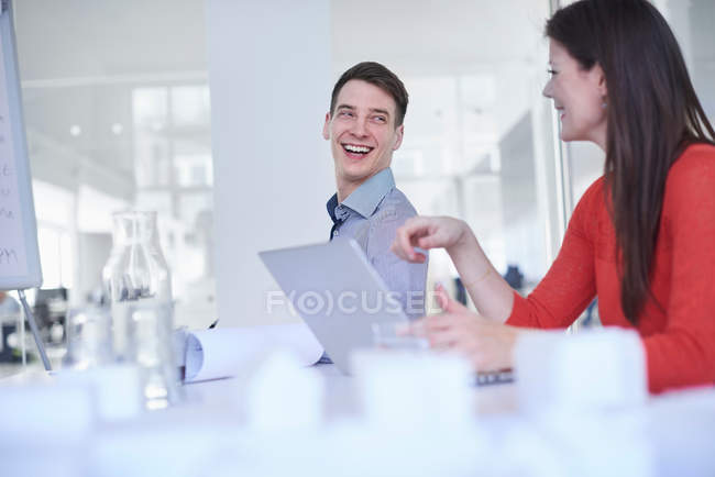Colleagues using laptop — Stock Photo