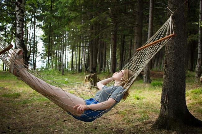 Woman resting in hammock — Stock Photo
