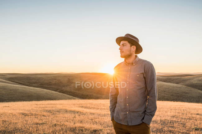 Man looking at rolling prairie hills — Stock Photo