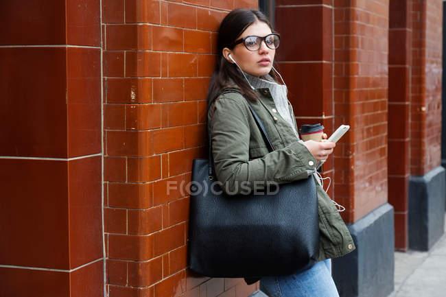 Woman waiting outside subway station — Stock Photo