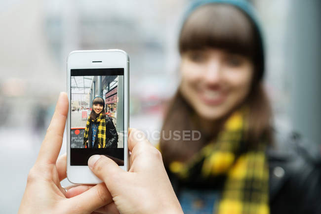 Female hands photographing best friend — Stock Photo