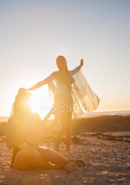 Young woman dancing on beach — Stock Photo