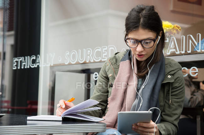 Young woman looking at digital tablet — Stock Photo