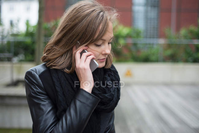 Young businesswoman making smartphone call — Stock Photo