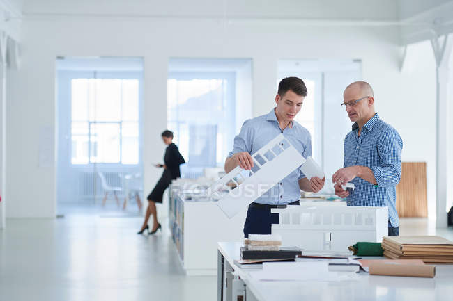 Architects in office looking at architectural model — Stock Photo