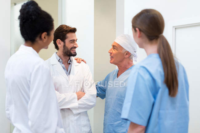 Group of doctors talking in hospital — Stock Photo
