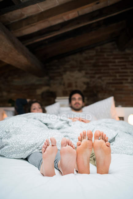 Bare feet soles of young couple — Stock Photo