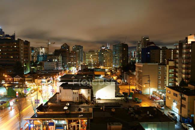 Cityscape illuminated at night — Stock Photo