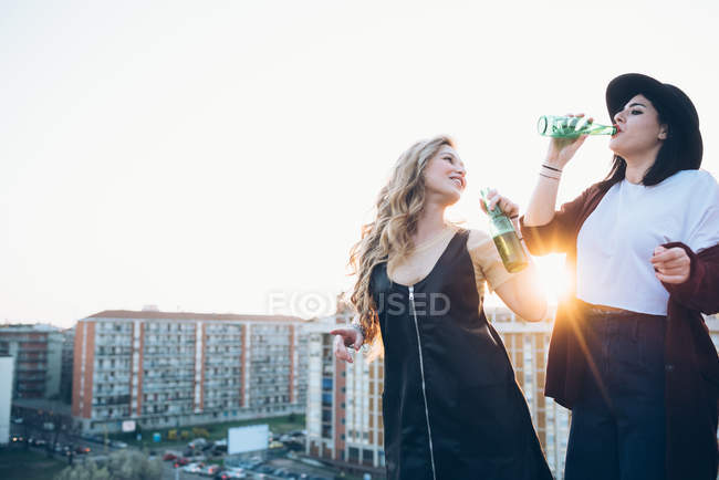 Two young women, on roof top — Stock Photo