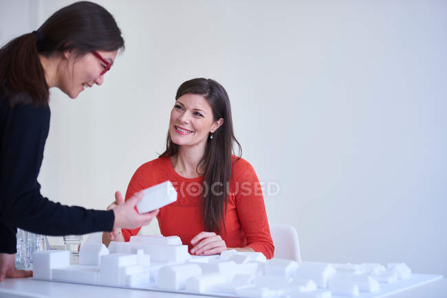Colleagues looking at architectural model — Stock Photo