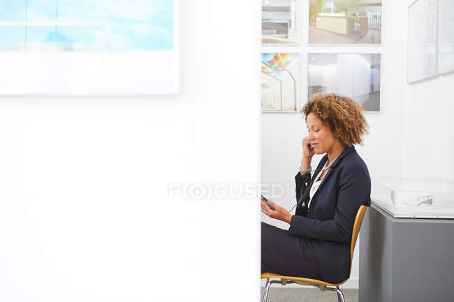 Female designer sitting in office — Stock Photo