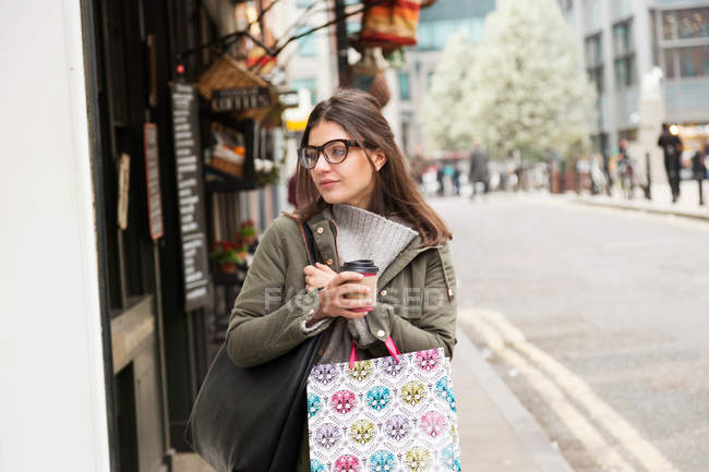 Young female shopper — Stock Photo