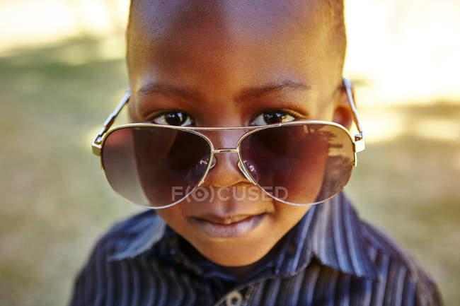 Boy wearing adult sunglasses — Stock Photo