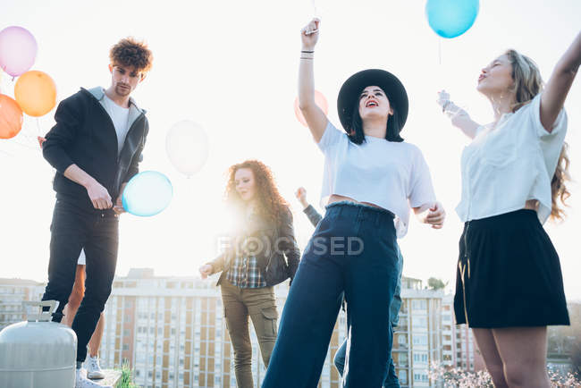 Group of enjoying roof party — Stock Photo