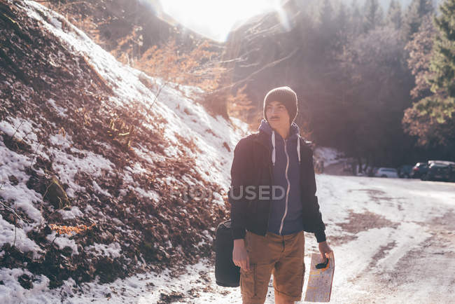 Male hiker looking from rural road — Stock Photo