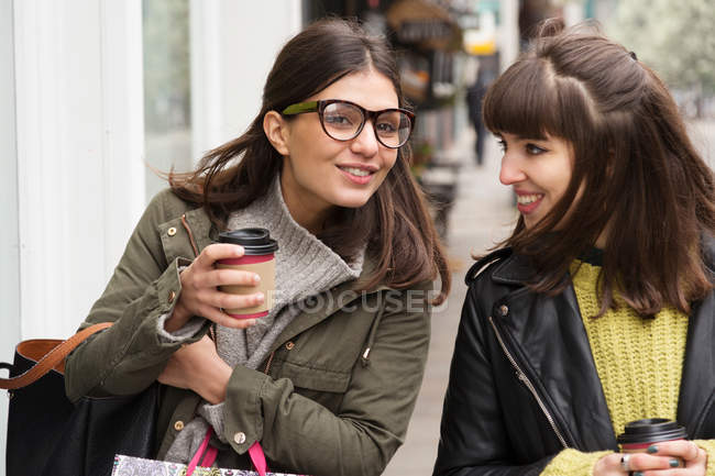 Two young female with takeaway coffee — Stock Photo