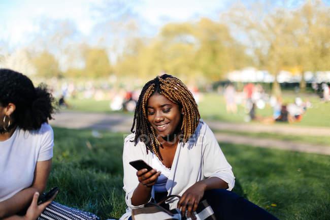 Teenage girl, sitting on grass — Stock Photo