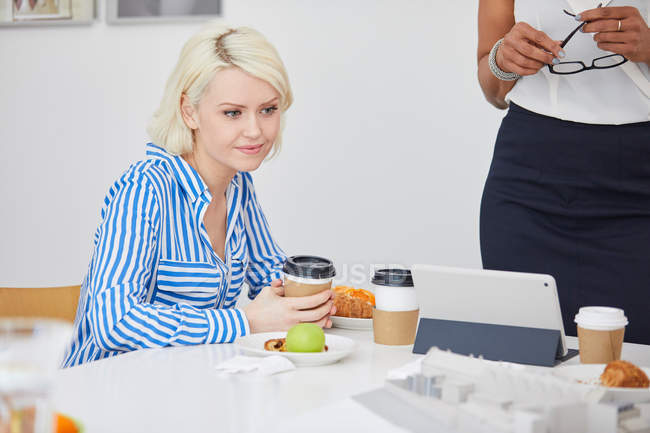 Female architect looking at architectural model — Stock Photo