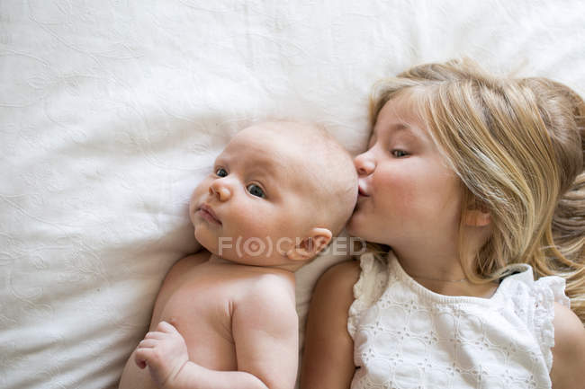 Young girl and baby brother — Stock Photo