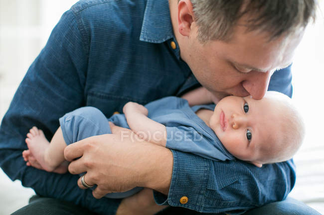 Father holding baby boy — Stock Photo