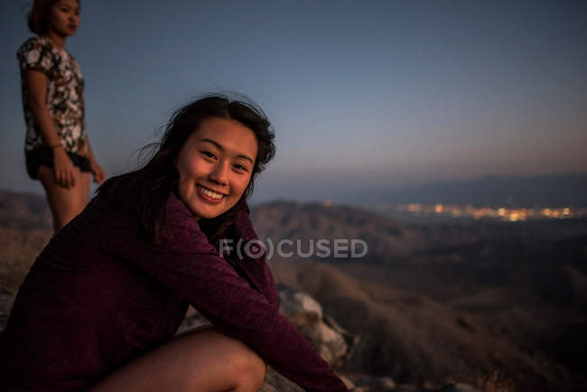 Portrait of young woman and friend — Stock Photo