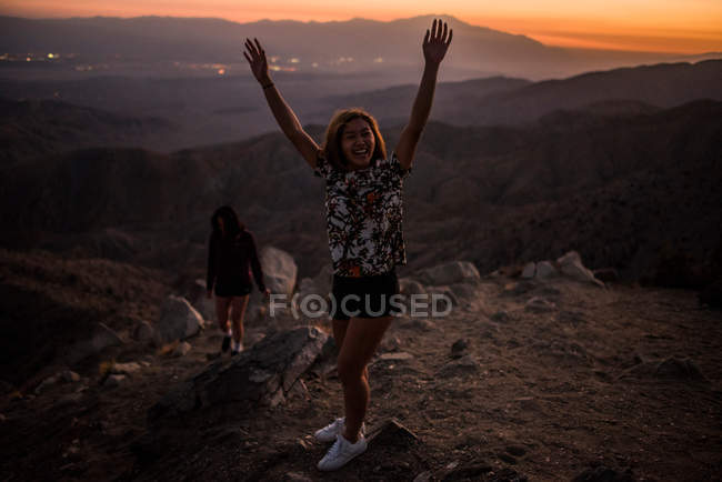 Young woman with hands raised — Stock Photo