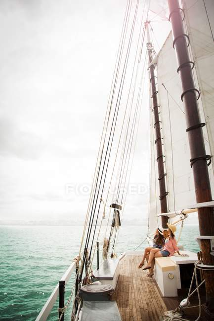 Two women on sailing boat — Stock Photo