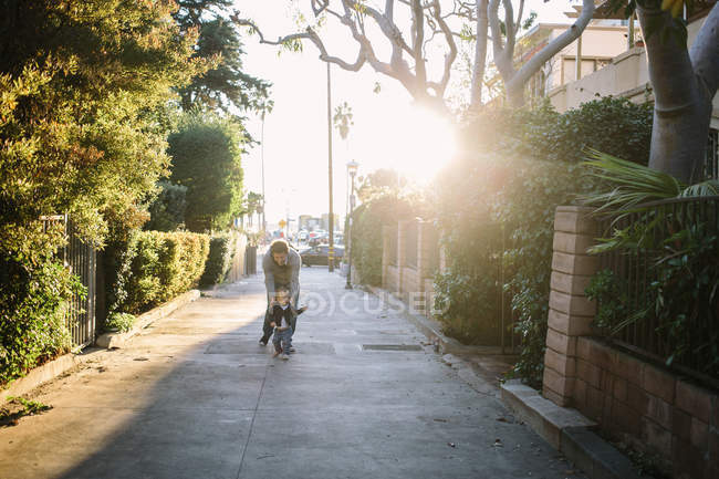Father and baby boy walking in street — Stock Photo